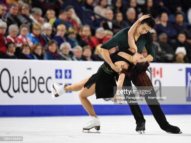 Shiyue Wang and Xinyu Liu of China compete on day two during the ISU Grand Prix of Figure Skating Skate Canada International at Place Bell on October...
