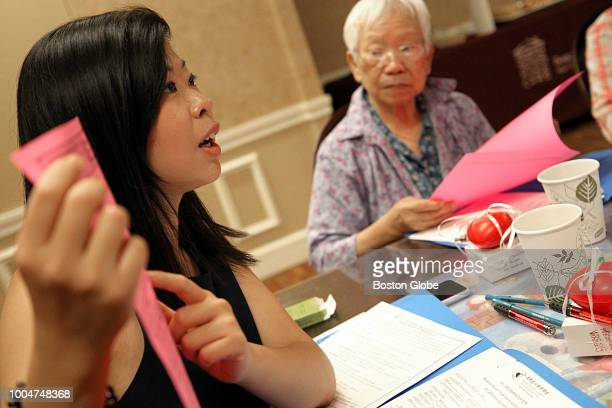 Shiyun Guan leads a class of seniors on end of life issues during a 'Heart to Heart Cafe' at the Kenmore Abbey Apartments in Boston on July 18 2018...