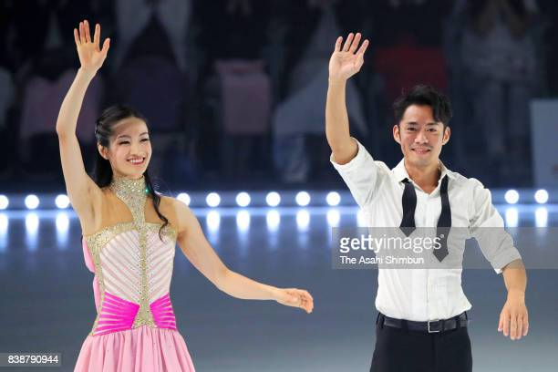 Shizuka Arakawa and Daisuke Takahashi wave during the rehearsal of the figure skating show 'Friends on Ice' at Shin Yokohama Skate Center on August...