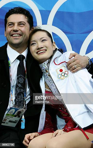 Shizuka Arakawa of Japan and her coach Nikolay Morozv await here score during the women's Short Program of the figure skating during Day 11 of the...