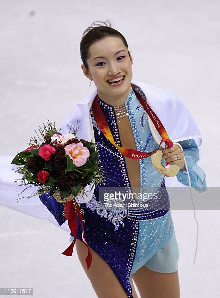 Shizuka Arakawa of Japan smiles with the gold medal during the women's Free Skating program of figure skating during Day 13 of the Turin 2006 Winter...