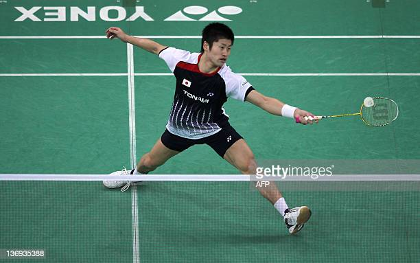Shizuka Matsuo of Japan returns a shot against Cheng Wen Hsing of China during their men's singles quaterfinals match at the Malaysia Open badminton...