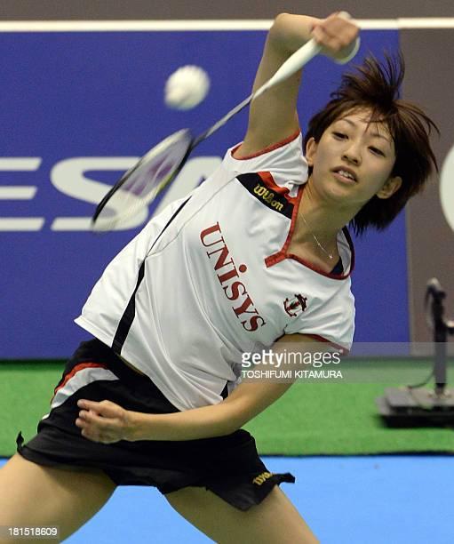 Shizuka Uchida of Japan hits a smash during her women's singles final match against 16-year-old Akane Yamaguchi of Japan at the Japan Open 2013...