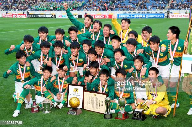 Shizuoka Gakuen players celebrate after the 98th All Japan High School Soccer Tournament final match between Aomori Yamada and Shizuoka Gakuen at the...