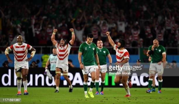Shizuoka Japan 28 September 2019 Conor Murray of Ireland looks on as Japan celebrate victory the 2019 Rugby World Cup Pool A match between Japan and...