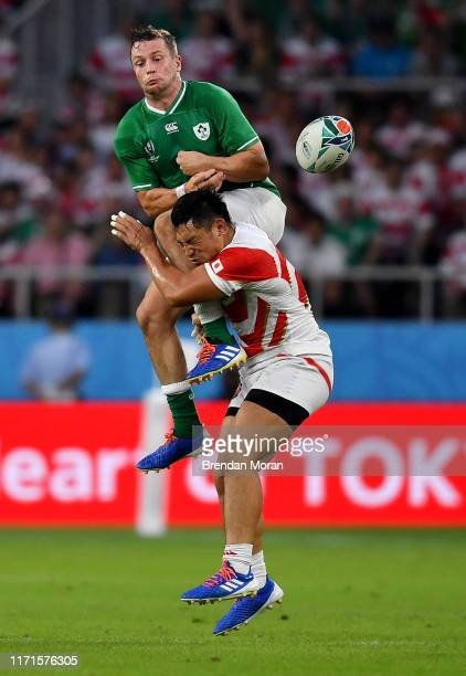 Shizuoka Japan 28 September 2019 Jack Carty of Ireland is tackled by Ryoto Nakamura of Japan during the 2019 Rugby World Cup Pool A match between...