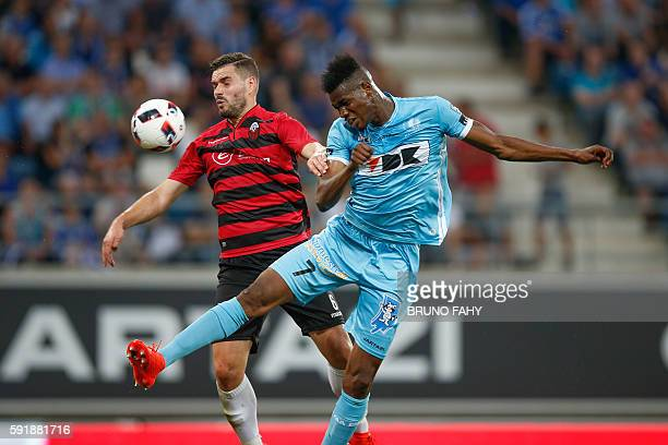 Shkendija's Ardian Cuculi and Gent's Kalika Coulibaly vie for the ball during the UEFA Europa League PlayOff first leg football match between...