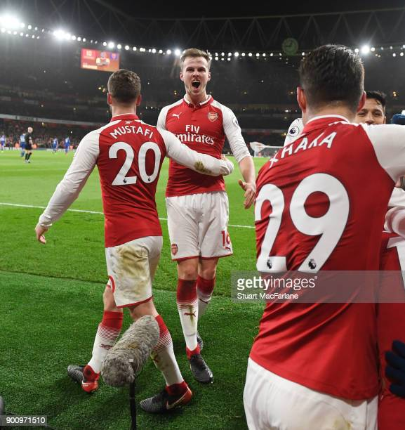 Shkodran Musraf and Rob Holding celebrate the 1st Arsenal goal scored by Jack Wilshere during the Premier League match between Arsenal and Chelsea at...