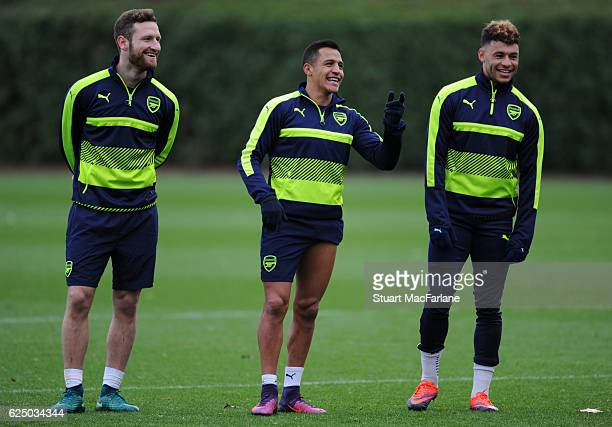 Shkodran Mustafi Alexis Sanchez and Alex OxladeChamberlain of Arsenal during a training session at London Colney on November 22 2016 in St Albans...