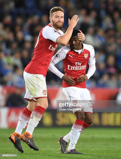 Shkodran Mustafi and Ainsley MaitlandNiles celebrate the Arsenal goal during the Premier League match between Leicester City and Arsenal at The King...