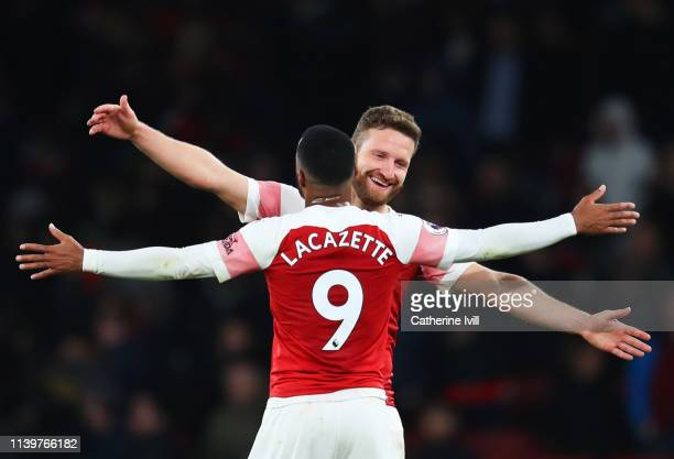 Shkodran Mustafi and Alexandre Lacazette of Arsenal celebrate victory after the the Premier League match between Arsenal FC and Newcastle United at...
