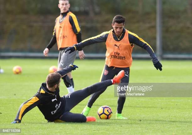 Shkodran Mustafi and Alexis Sanchez of Arsenal during a training session at London Colney on March 1 2017 in St Albans England