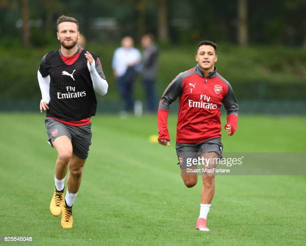 Shkodran Mustafi and Alexis Sanchez of Arsenal during a training session at London Colney on August 2 2017 in St Albans England