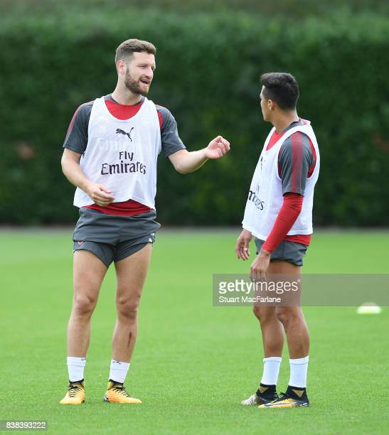 Shkodran Mustafi and Alexis Sanchez of Arsenal during a training session at London Colney on August 24 2017 in St Albans England
