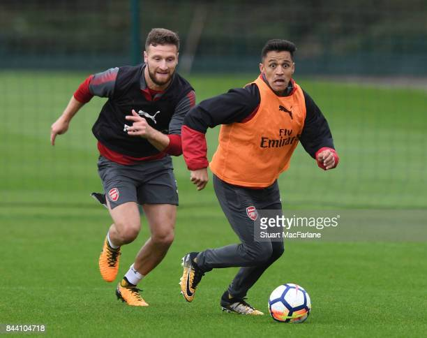Shkodran Mustafi and Alexis Sanchez of Arsenal during a training session at London Colney on September 8 2017 in St Albans England