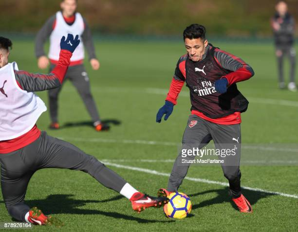 Shkodran Mustafi and Alexis Sanchez of Arsenal during a training session at London Colney on November 25 2017 in St Albans England