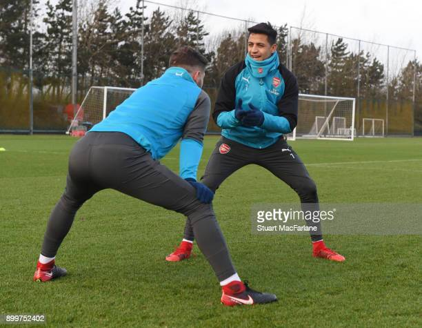Shkodran Mustafi and Alexis Sanchez of Arsenal during a training session at London Colney on December 30 2017 in St Albans England