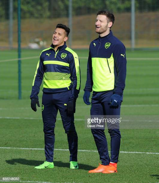 Shkodran Mustafi and Alexis Sanchez of Arsenal during the Arsenal Training Session at London Colney on February 14 2017 in St Albans England