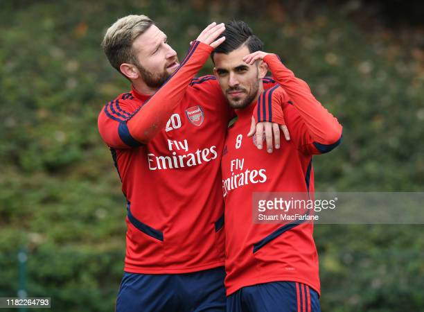 Shkodran Mustafi and Dani Cebllos of Arsenal after a training session at London Colney on October 20, 2019 in St Albans, England.