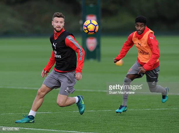 Shkodran Mustafi and Gedion Zelalem of Arsenal during a training session at London Colney on November 5 2016 in St Albans England