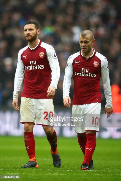 Shkodran Mustafi and Jack Wilshere of Arsenal look dejected following the Premier League match between Tottenham Hotspur and Arsenal at Wembley...