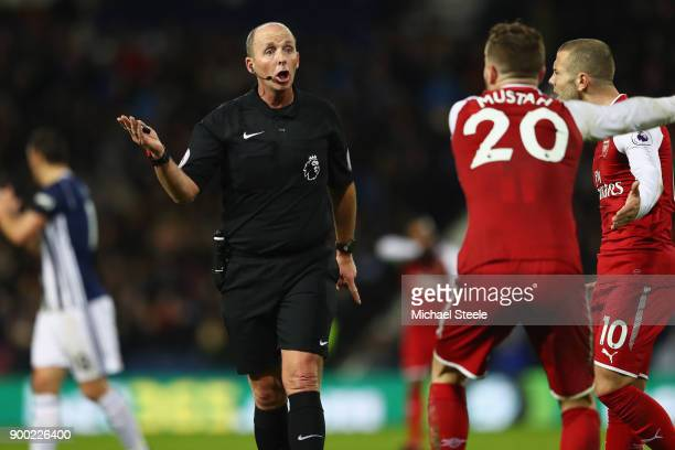 Shkodran Mustafi and Jack Wilshere of Arsenal protest to Referee Mike Dean during the Premier League match between West Bromwich Albion and Arsenal...