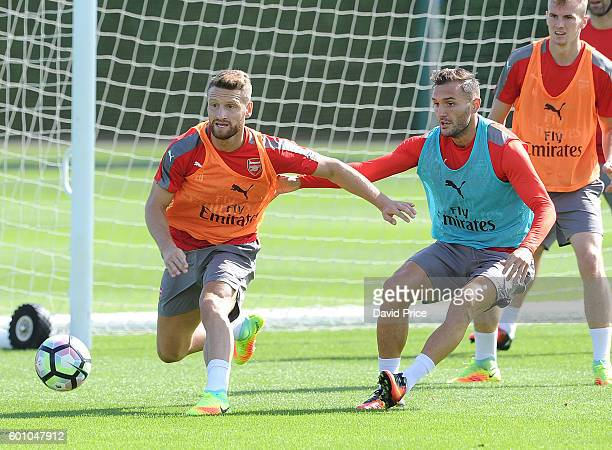 Shkodran Mustafi and Lucas Perez of Arsenal during Arsenal Training Session at London Colney on September 9 2016 in St Albans England