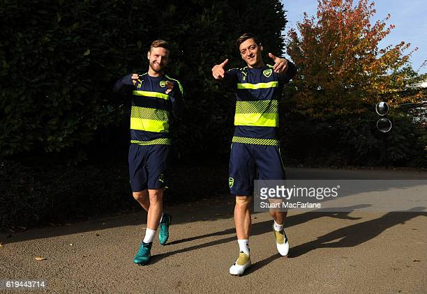 Shkodran Mustafi and Mesut Ozil of Arsenal during a training session at London Colney on October 31 2016 in St Albans England