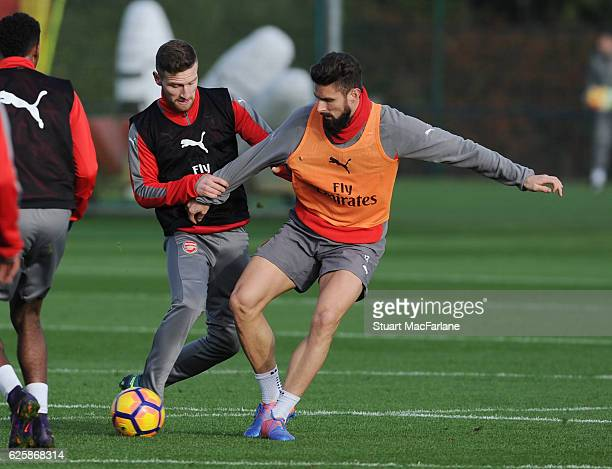 Shkodran Mustafi and Olivier Giroud of Arsenal during a training session in preparation for the Premier League match against AFC Bournemouth at...