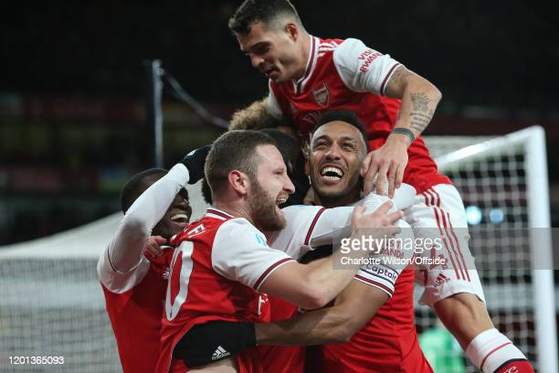 Shkodran Mustafi and Pierre-Emerick Aubameyang of Arsenal celebrate their 2nd goal during the Premier League match between Arsenal FC and Newcastle...