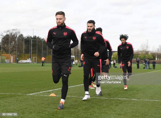 Shkodran Mustafi and Sead Kolasinac of Arsenal during a training session at London Colney on March 14 2018 in St Albans England