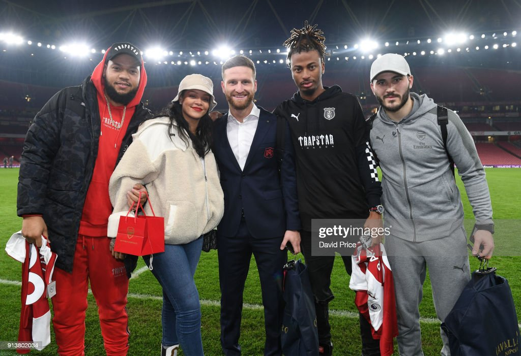 Shkodran Mustafi (C) and Sead Kolasinac (R) of Arsenal meet pop star Rihanna after the Premier League match between Arsenal and Everton at Emirates Stadium on February 3, 2018 in London, England.