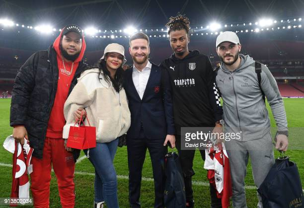 Shkodran Mustafi and Sead Kolasinac of Arsenal meet pop star Rihanna after the Premier League match between Arsenal and Everton at Emirates Stadium...