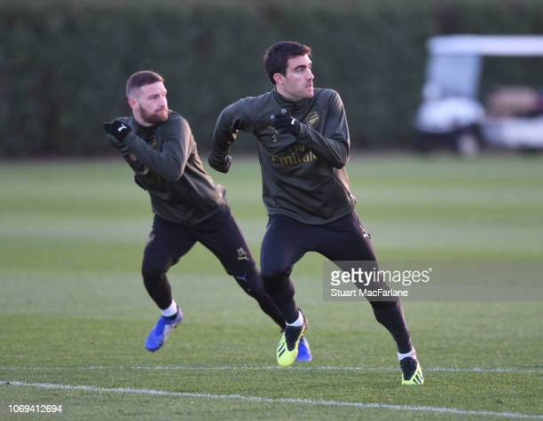Shkodran Mustafi and Sokratis of Arsenal during a training session at London Colney on December 7 2018 in St Albans England