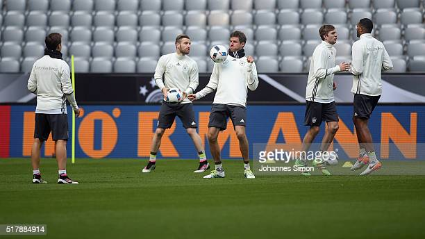 Shkodran Mustafi and Thomas Mueller of Germany and team mates participate in the training session ahead of the international friendly match between...