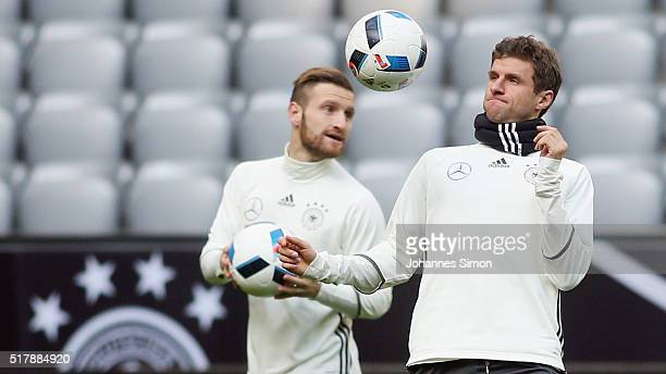 Shkodran Mustafi and Thomas Mueller of Germany participate in the training session ahead of the international friendly match between Germany and...