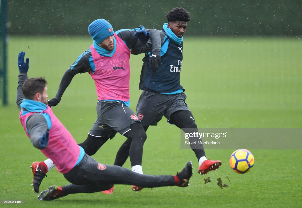 Shkodran Mustafi, Calum Chambers and Ainsley Maitland-Niles of Arsenal during a training session at London Colney on December 27, 2017 in St Albans, England.