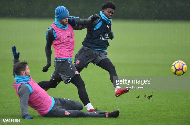 Shkodran Mustafi Calum Chambers and Ainsley MaitlandNiles of Arsenal during a training session at London Colney on December 27 2017 in St Albans...
