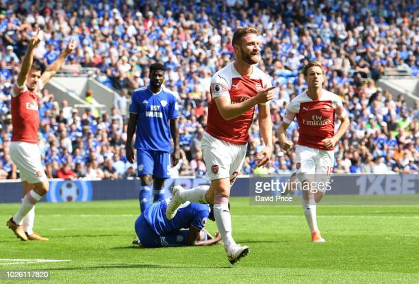 Shkodran Mustafi celebrates scoring a goal for Arsenal during the Premier League match between Cardiff City and Arsenal FC at Cardiff City Stadium on...