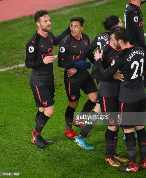 Shkodran Mustafi celebrates scoring a goal for Arsenal with Alexis Sanchez during the Premier League match between Crystal Palace and Arsenal at...