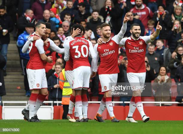 Shkodran Mustafi celebrates scoring Arsenal's 1st goal with Sead Kolasinac during the Premier League match between Arsenal and Watford at Emirates...