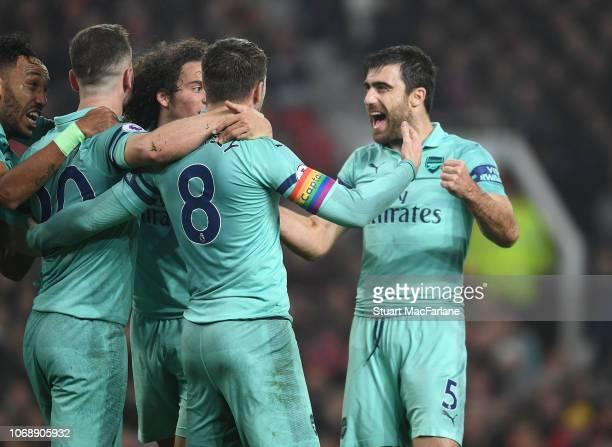 Shkodran Mustafi celebrates scoring the 1st Arsenal goal with Matteo Guendouzi Aaron Ramsey and Sokratis during the Premier League match between...