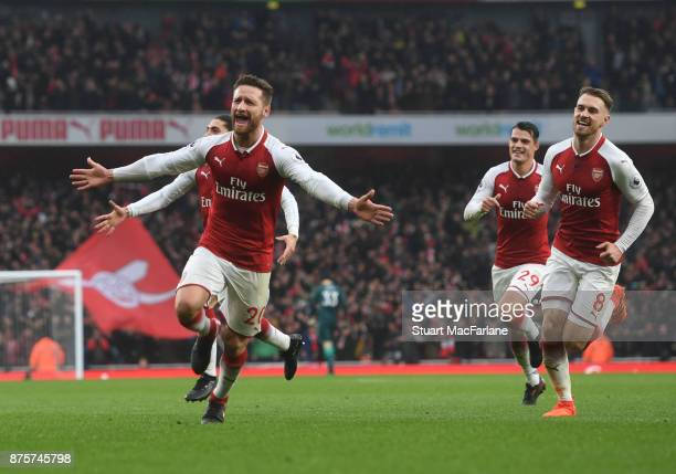 Shkodran Mustafi celebrates scoring the first Arsenal goal with Aaron Ramsey during the Premier League match between Arsenal and Tottenham Hotspur at...