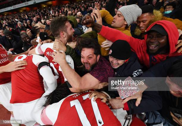 Shkodran Mustafi celebrates the Arsenal goal with the fans during the Premier League match between Arsenal FC and Liverpool FC at Emirates Stadium on...