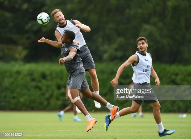 Shkodran Mustafi Chuba Akpom and Konstantinos Mavropanos of Arsenal during a training session at London Colney on July 16 2018 in St Albans England