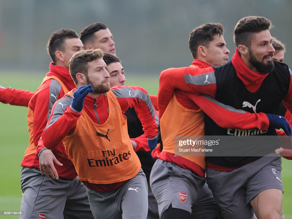 Shkodran Mustafi, Gabriel and Olivier Giroud of Arsenal during a training session at London Colney on December 9, 2016 in St Albans, England.