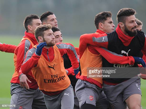 Shkodran Mustafi Gabriel and Olivier Giroud of Arsenal during a training session at London Colney on December 9 2016 in St Albans England