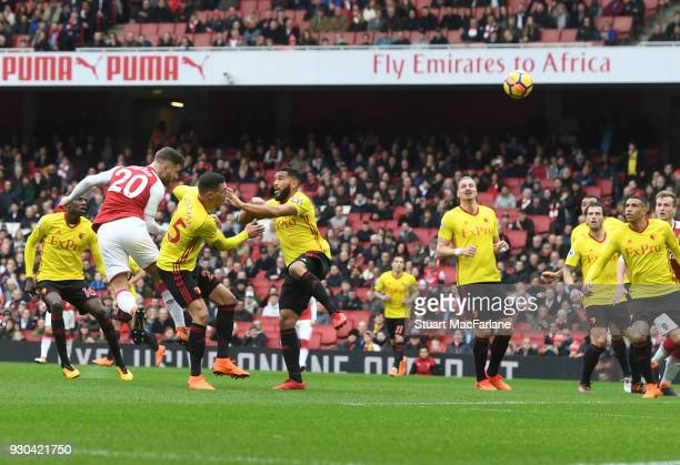 Shkodran Mustafi heads past Watford goalkeeper Orestis Karnezis to score for Arsenal during the Premier League match between Arsenal and Watford at...