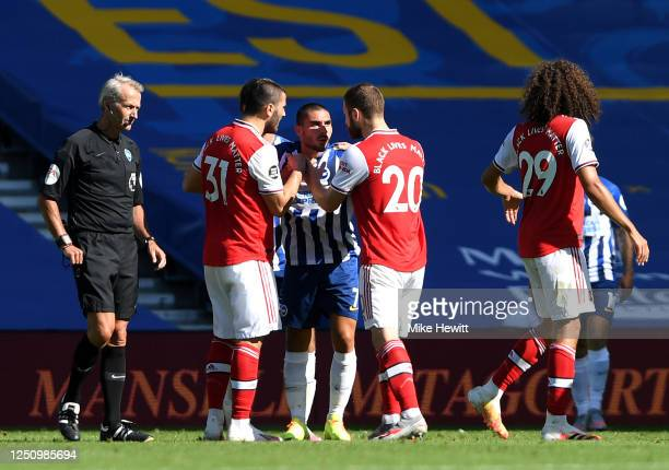 Shkodran Mustafi Matteo Guendouzi and Sead Kolasinac of Arsenal confront Neal Maupay of Brighton and Hove Albion after the Premier League match...