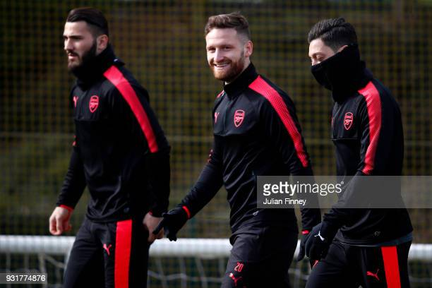 Shkodran Mustafi Mesut Ozil and Sead Kolasinac of Arsenal during an Arsenal Training Session ahead of there Europa League 2nd Leg match against AC...